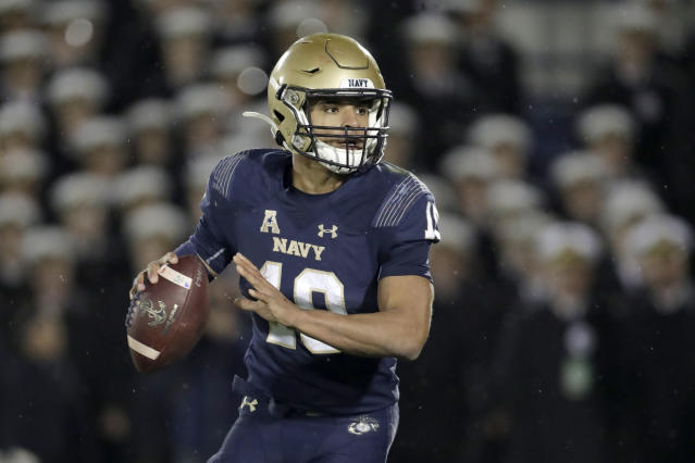 Navy quarterback Malcolm Perry looks to pass against SMU during the second half of an NCAA college football game, Saturday, Nov. 23, 2019, in Annapolis, Md. Navy won 35-28. (AP Photo/Julio Cortez)