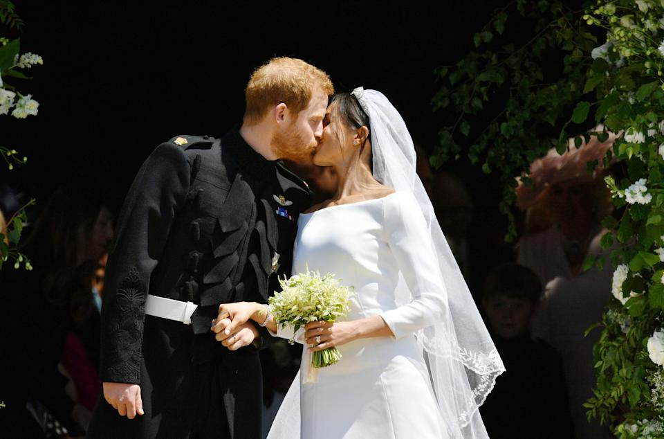 The newlyweds kiss on the West Steps following their marriage service [Photo: Getty]