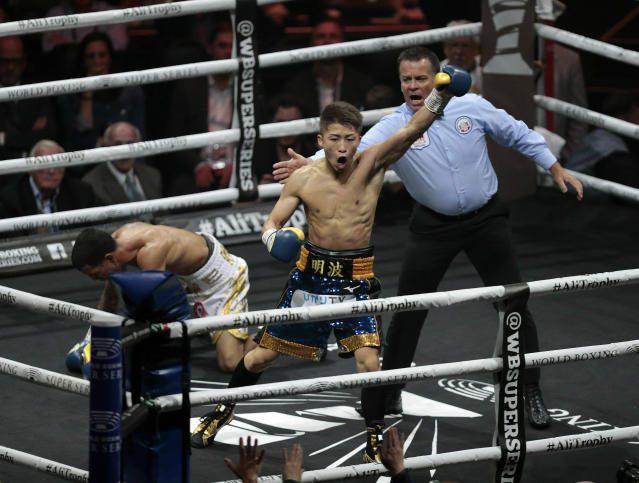 Naoye Inoue, right, of Japan, celebrates knocking down Emmanuel Inoue, of Puerto Rico during an IBF world bantamweight boxing match at The SSE Hydro, Saturday, May 18, 2019, in Glasgow, Scotland. (Graham Stuart/PA via AP)