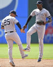 New York Yankees' Cameron Maybin, right, is congratulated by Gleyber Torres after defeating the Cleveland Indians 7-6 in a baseball game, Sunday, June 9, 2019, in Cleveland. (AP Photo/David Dermer)