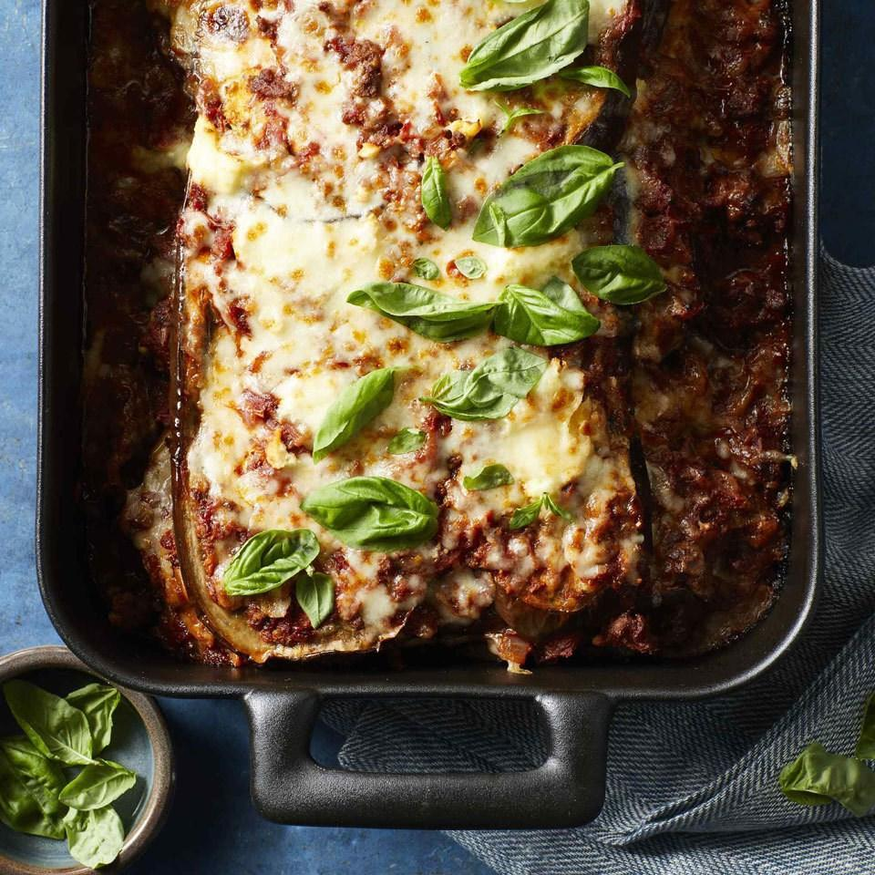 """<p>Satisfy your craving for cheesy, indulgent lasagna with this noodle-less version. Roasted eggplant slices stand in for noodles in this low-carb, gluten-free lasagna. <a href=""""https://www.eatingwell.com/recipe/266456/no-noodle-eggplant-lasagna/"""" rel=""""nofollow noopener"""" target=""""_blank"""" data-ylk=""""slk:View Recipe"""" class=""""link rapid-noclick-resp"""">View Recipe</a></p>"""