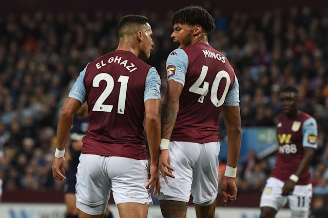 Aston Villa's Anwar El Ghazi and Tyrone Mings square-up. (Photo by Paul ELLIS / AFP)