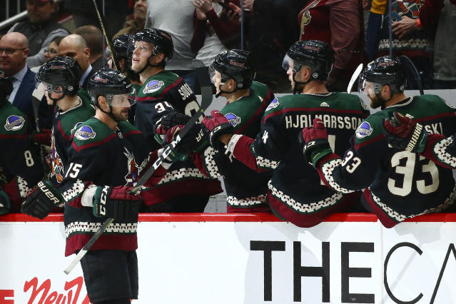Arizona Coyotes center Brad Richardson celebrates his goal against the Tampa Bay Lightning with Carl Soderberg (34), Aaron Ness (42), Niklas Hjalmarsson (4) and Alex Goligoski (33) during the second period of an NHL hockey game Saturday, Feb. 22, 2020, in Glendale, Ariz. (AP Photo/Ross D. Franklin)