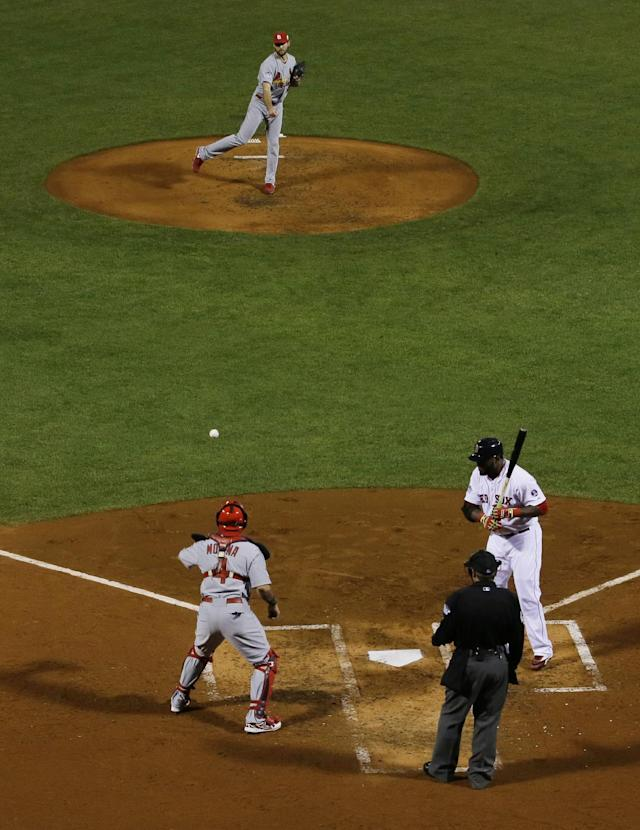 St. Louis Cardinals catcher Yadier Molina, right, catches a ball from pitcher Michael Wacha as Boston Red Sox designated hitter David Ortiz, right, is intentionally walked during the third inning of Game 6 of baseball's World Series Wednesday, Oct. 30, 2013, in Boston. (AP Photo/Matt Slocum)