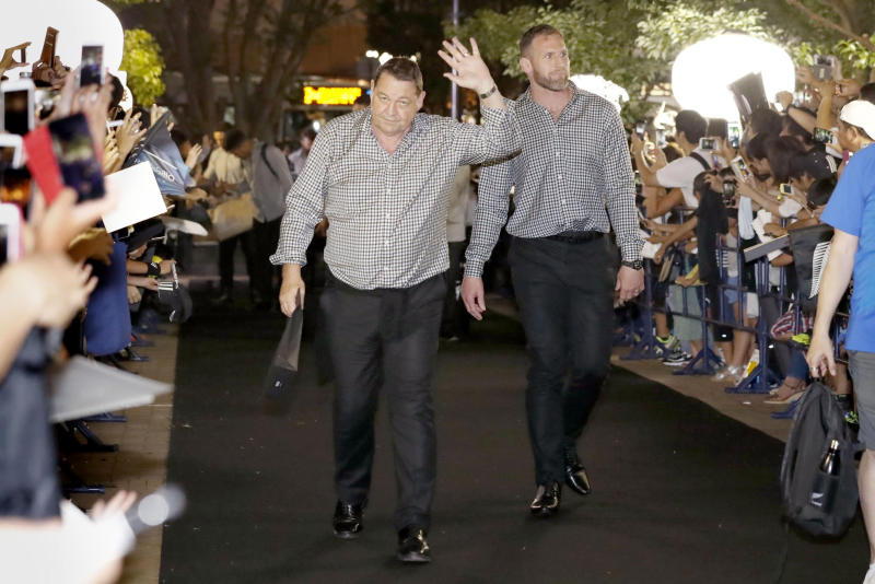 New Zealand All Blacks' Kieran Read, right, and coach Steve Hansen, left, arrive at a camp venue for the Rugby World Cup in Kashiwa, near Tokyo, Monday, Sept. 9, 2019. (Kyodo News via AP)