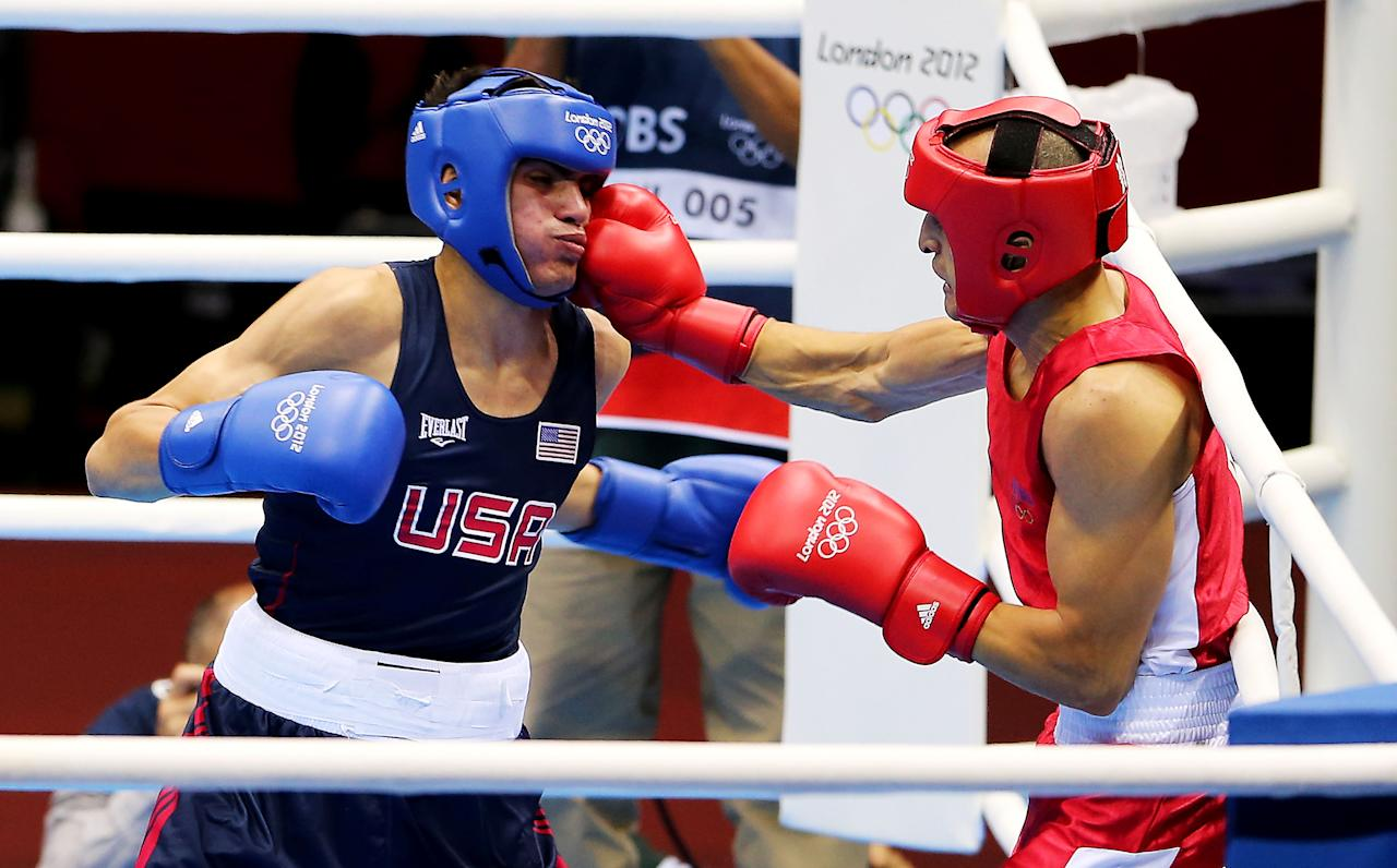 LONDON, ENGLAND - JULY 29:  Jose Ramirez of United States (L) in action with Rachid Azzedine of France during their Men's Light (60kg) Boxing bout on day 2 of the London 2012 Olympic Games at ExCeL on July 29, 2012 in London, England.  (Photo by Scott Heavey/Getty Images)