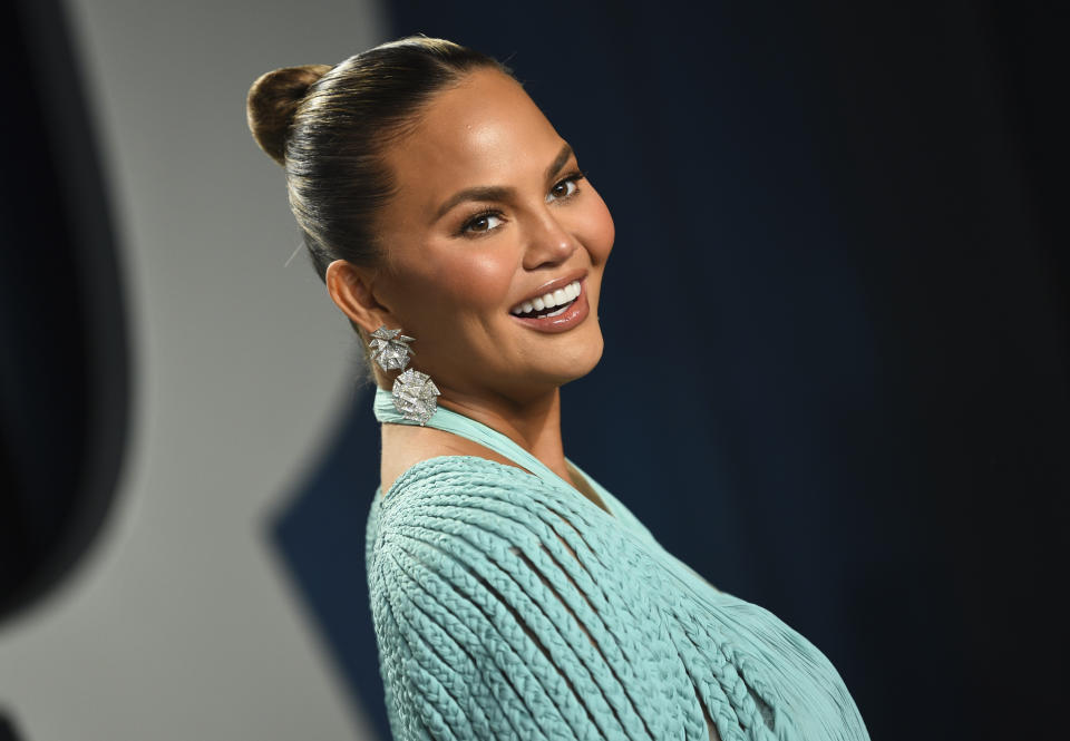 Chrissy Teigen arrives at the Vanity Fair Oscar Party on Sunday, Feb. 9, 2020, in Beverly Hills, Calif. (Photo by Evan Agostini/Invision/AP)