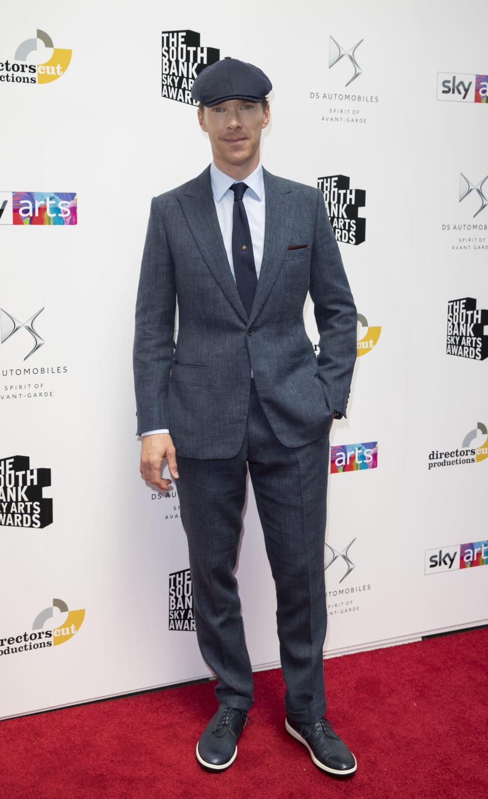 <p>Benedict Cumberbatch dressed the part for The Southbank Sky Awards on 1 July in a two-piece suit and flat cap. <em>[Photo: Getty]</em> </p>