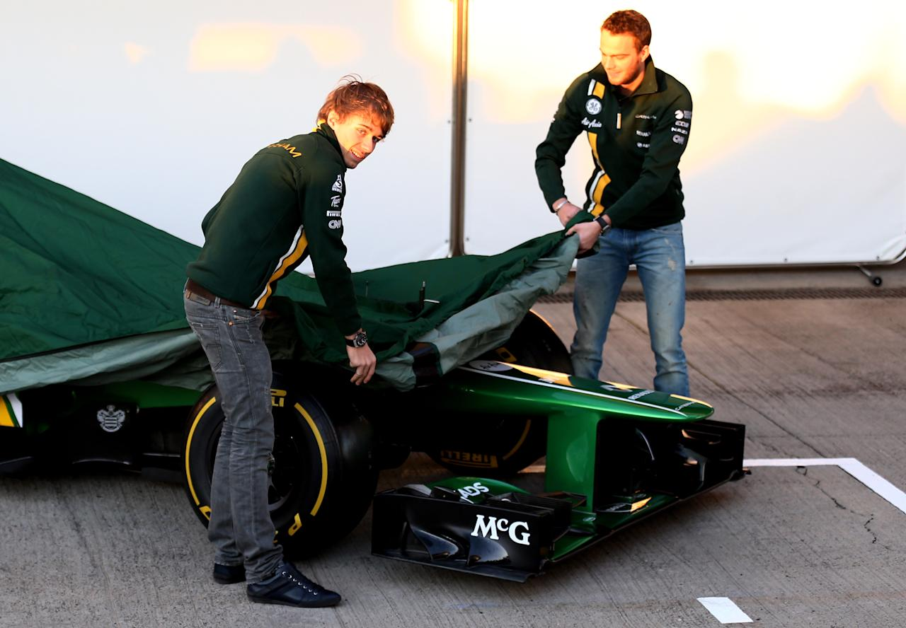 JEREZ DE LA FRONTERA, SPAIN - FEBRUARY 05:  (L-R) Charles Pic of France and Caterham and Giedo van der Garde of Netherlands and Caterham unveil the CT03 car at the Caterham F1 launch during Formula One winter testing at Circuito de Jerez on February 5, 2013 in Jerez de la Frontera, Spain.  (Photo by Paul Gilham/Getty Images)