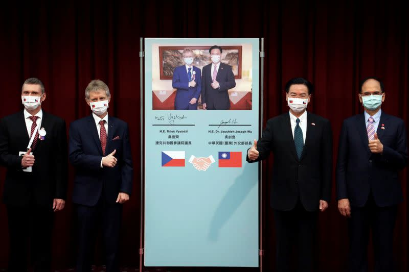 Czech Senate President Milos Vystrcil and Taiwan's Foreign Minister Joseph Wu pose for a group photo after a joint news conference in Taipei