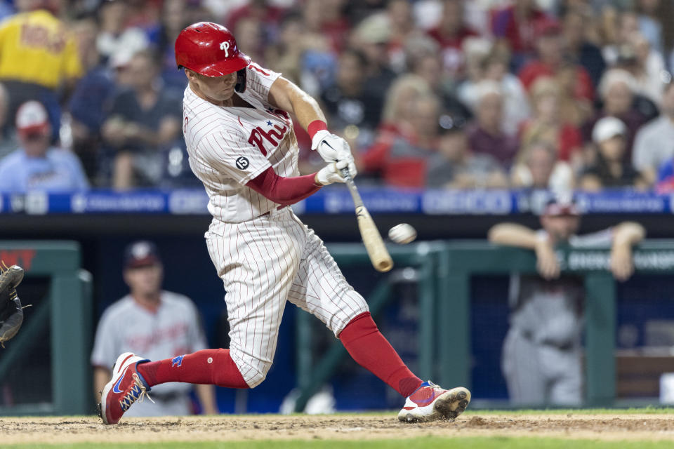Philadelphia Phillies' Rhys Hoskins hits a three-run homer during the sixth inning of a baseball game against the Washington Nationals, Monday, July 26, 2021, in Philadelphia. (AP Photo/Laurence Kesterson)