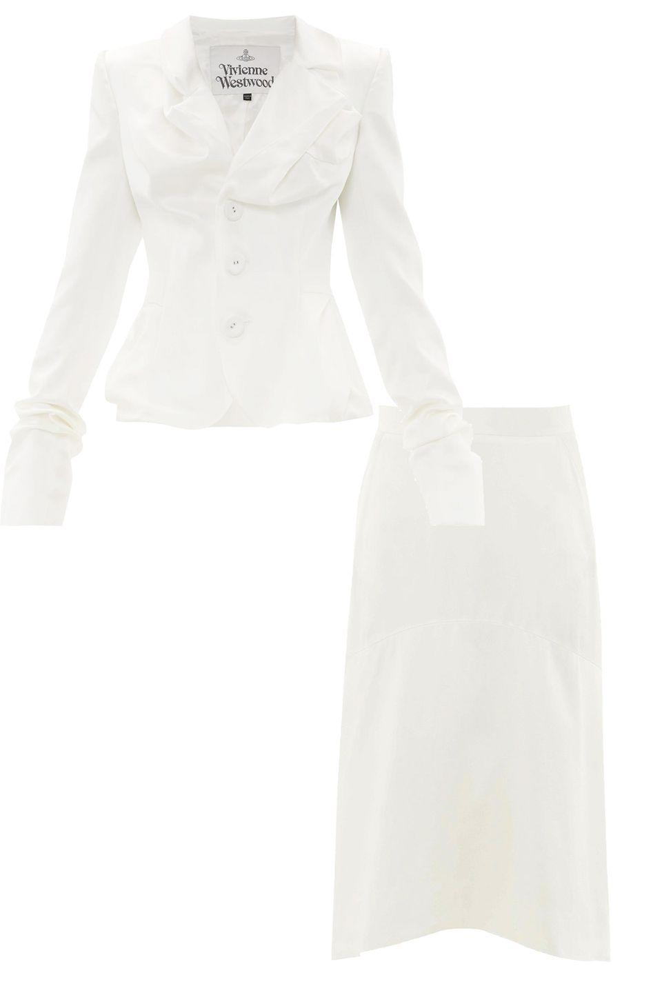 """<p>Courthouse chic with a touch of rebellion? Leave it to Vivienne Westwood with this skirt suit set. Complete the wedding day look with simple jewelry and tousled waves.</p><p><a href=""""https://go.skimresources.com?id=74968X1525087&xs=1&url=https%3A%2F%2Fwww.matchesfashion.com%2Fus%2Fproducts%2FVivienne-Westwood-Draped-single-breasted-satin-jacket-1336645"""" rel=""""nofollow noopener"""" target=""""_blank"""" data-ylk=""""slk:Vivienne Westwood Blazer"""" class=""""link rapid-noclick-resp"""">Vivienne Westwood Blazer<br></a><a href=""""https://go.skimresources.com?id=74968X1525087&xs=1&url=https%3A%2F%2Fwww.matchesfashion.com%2Fus%2Fproducts%2FVivienne-Westwood-Curved-hem-charmeuse-skirt-1336643"""" rel=""""nofollow noopener"""" target=""""_blank"""" data-ylk=""""slk:Vivienne Westwood Skirt"""" class=""""link rapid-noclick-resp"""">Vivienne Westwood Skirt</a></p>"""