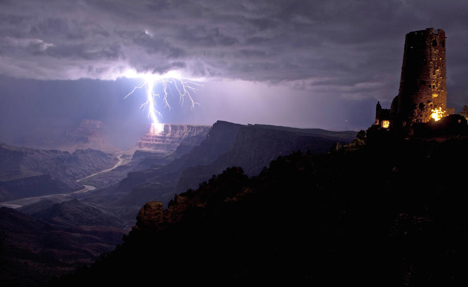 This is the incredible moment a fierce lightning bolt crashed against the Grand Canyon illuminating the steep canyon walls. Shrouded in darkness, the breath-taking landscape was shocked into life as mother nature sent the bolt storming down to Earth. As it cracked against the rocks the bright blue bolt illuminated the South Rim of the canyon, considered one of the Seven Natural Wonders of the World. With just the Desert View Watchtower in the foreground, the lightning was perfectly framed by the canyon which is located in Arizona, USA. (Travis Roe/ U.S. Dept. of the Interior / Caters News)