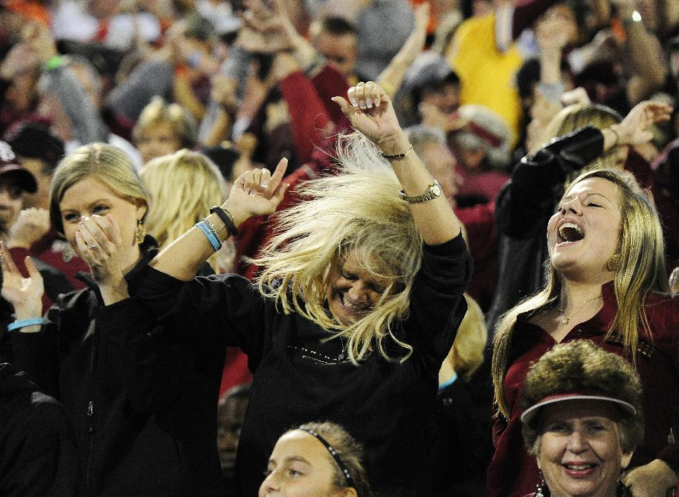 Florida State fans celebrate a Florida State touchdown against Clemson during the first half of an NCAA college football game, Saturday, Oct. 19, 2013, in Clemson, S.C. (AP Photo/Richard Shiro)