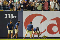 Yankee Stadium grounds crew members try to catch a cat that entered the field in the eighth inning of a baseball game between the New York Yankees and the Baltimore Orioles, Monday, Aug. 2, 2021, in New York. (AP Photo/Mary Altaffer)