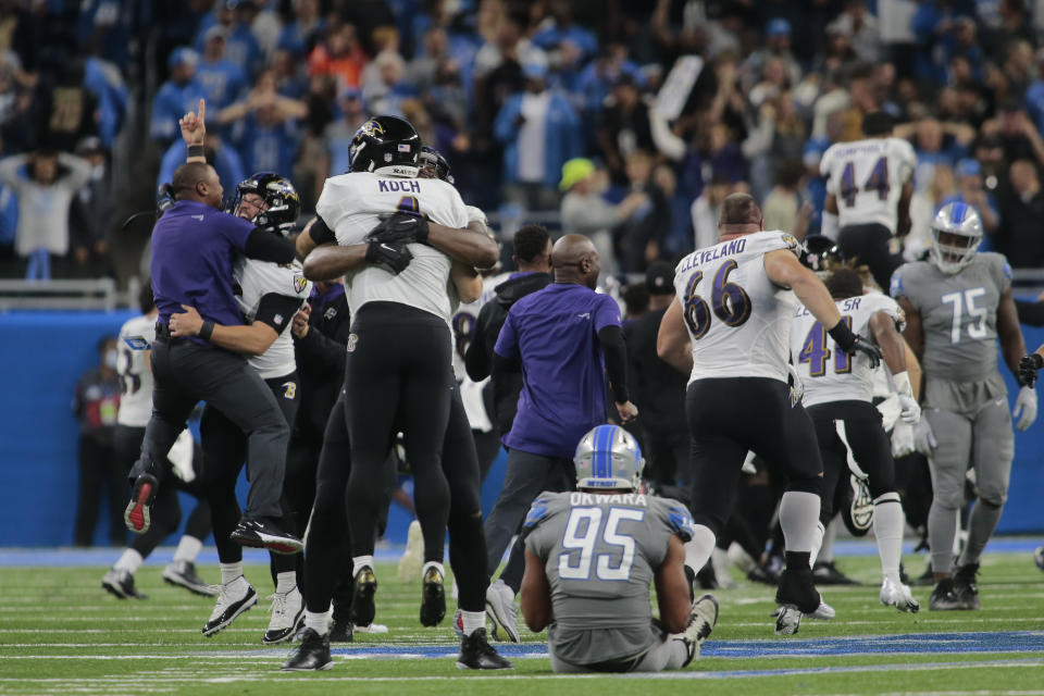 Baltimore Ravens players celebrate a Justin Tucker 66-yard field goal as Detroit Lions linebacker Romeo Okwara (95) sits on the field in the second half of an NFL football game against the Detroit Lions in Detroit, Sunday, Sept. 26, 2021. Baltimore won 19-17. (AP Photo/Tony Ding)