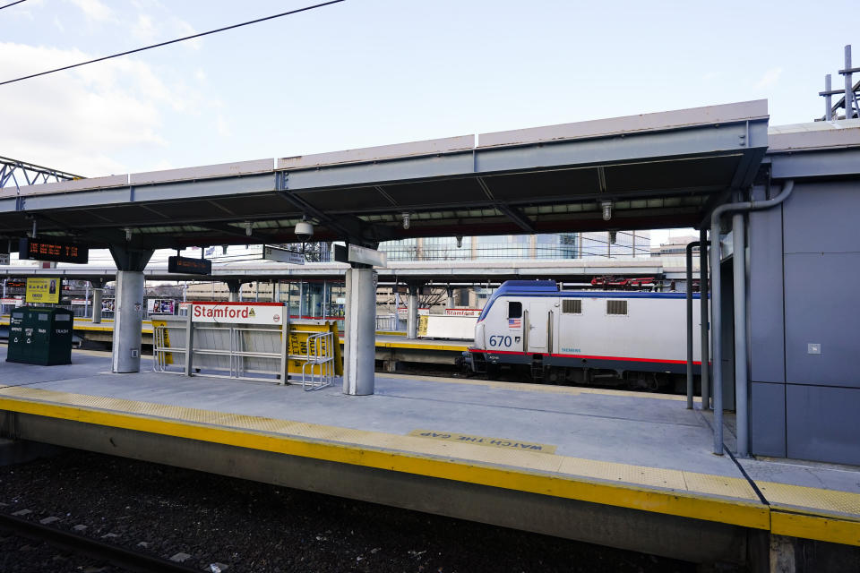 A train arrives at the Stamford train station Tuesday, Dec. 29, 2020, in Stamford, Conn. With many New Yorkers moving to neighboring Connecticut during the pandemic, especially Fairfield County, it's becoming more challenging for people to find affordable homes to buy. (AP Photo/Frank Franklin II)