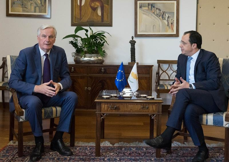 EU chief Brexit negotiator Michel Barnier (L) and Cypriot Foreign Minister Nikos Christodoulidis meet in Nicosia on May 20, 2019