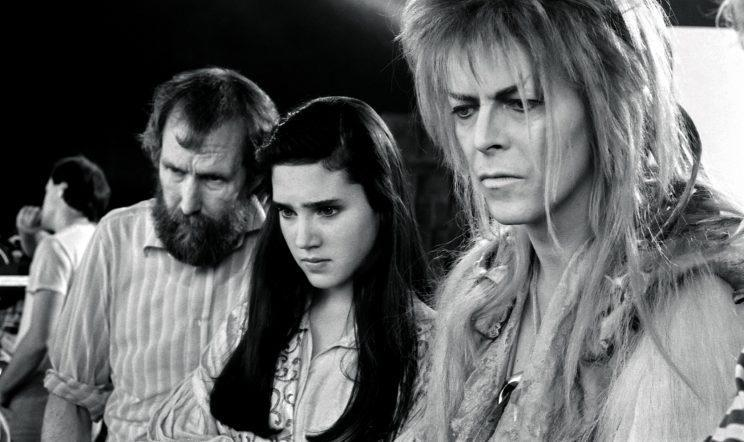 Henson, Connelly, and Bowie are all business as they watch a playback. Author Terry Erdmann says this is one of his favorite images of Bowie from the set because of the