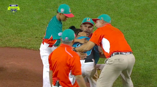 Members of Venezuela comforted Dominican Republic pitcher Edward Uceta after he gave up a walk-off hit. (Screen shot via Deadspin)