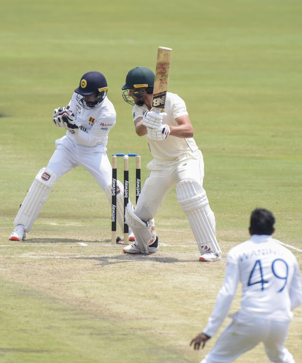 South Africa's Wiaan Mulder is caught from behind by Sri Lanka's Niroshan Dickwella, on day three of the first cricket test match between South Africa and Sri Lanka at Super Sport Park Stadium in Pretoria, South Africa, Monday, Dec. 28 2020. (AP Photo/Catherine Kotze)