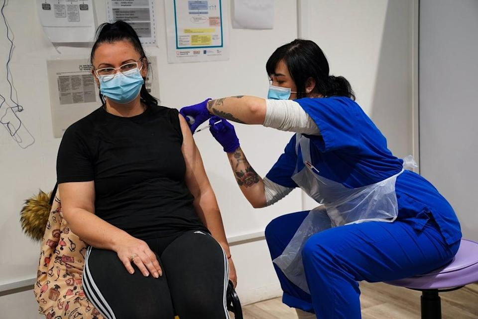 A woman receives a jab at the vaccination centre (Kirsty O'Connor/PA) (PA Wire)