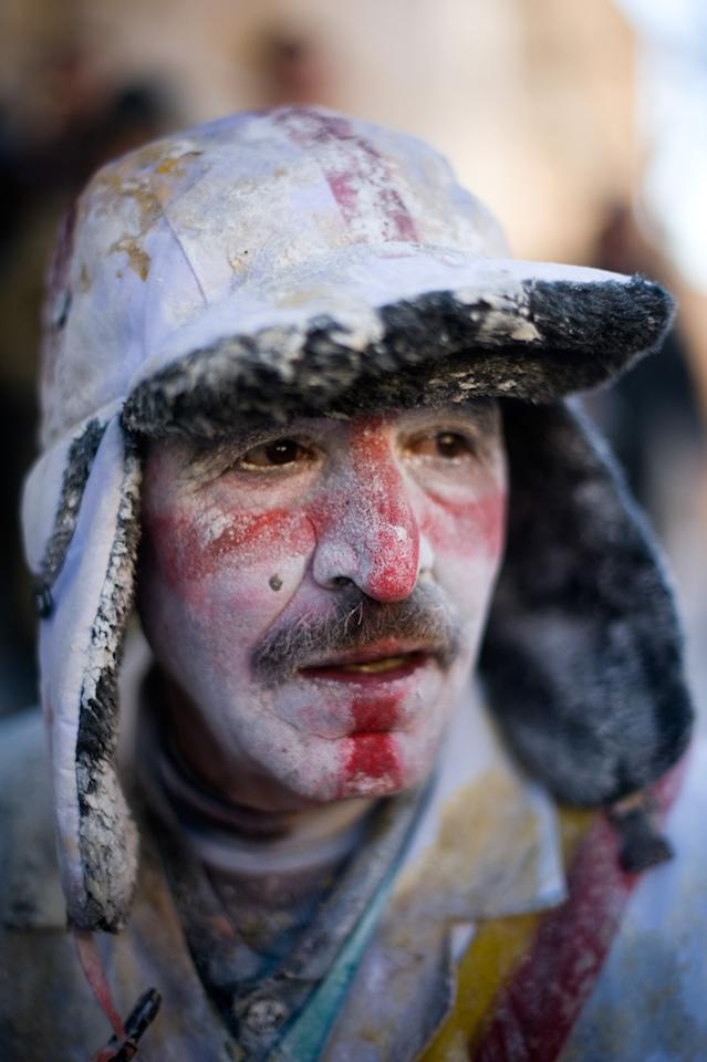 IBI, SPAIN - DECEMBER 28:  A Reveller poses after taking part in the battle of 'Enfarinats', a flour fight in celebration of the Els Enfarinats festival on December 28, 2012 in Ibi, Spain. Citizens of Ibi annually celebrate the festival with a battle using flour, eggs and firecrackers. The battle takes place between two groups, a group of married men called 'Els Enfarinats' which take the control of the village for one day pronouncing a whole of ridiculous laws and fining the citizens that infringe them and a group called 'La Oposicio' which try to restore order. At the end of the day the money collected from the fines is donated to charitable causes in the village. The festival has been celebrated since 1981 after the town of Ibi recovered the tradition but the origins remain unknown.   (Photo by David Ramos/Getty Images)