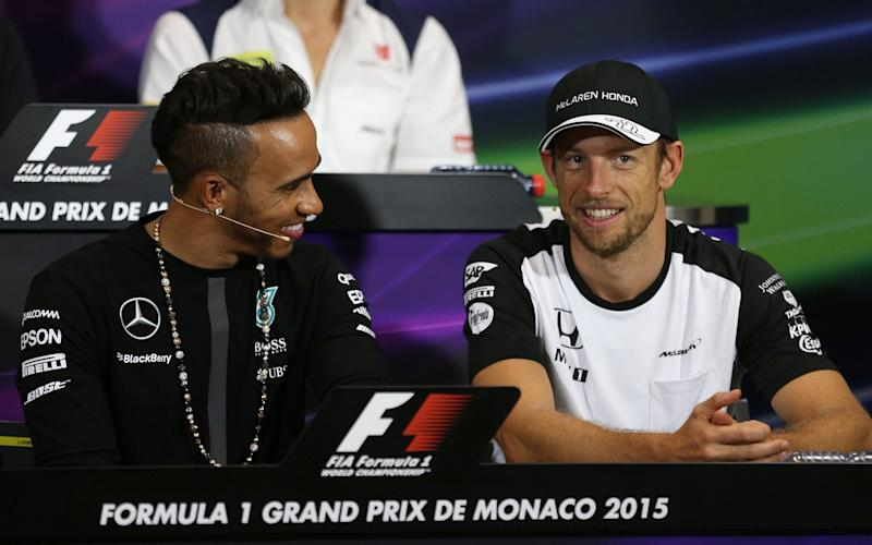 Jenson Button and former McLaren teammate Lewis Hamilton - Credit: PA