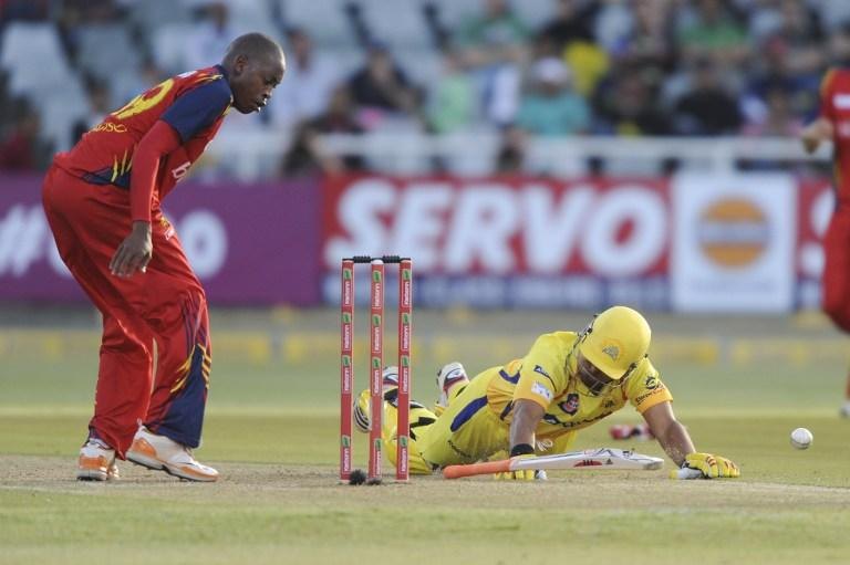 Suresh Raina (R) of the Chennai Super Kings slides towards his crease  on October 16, 2012 during Match 7 of the Champions League T20 (CLT20) between the Chennai Super Kings (India) and the Highveld Lions (South Africa) at  the Newlands Cricket Stadium in Cape Town. AFP PHOTO / Roger Sedres
