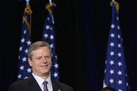 Massachusetts Governor Charlie Baker waits to speak at a news conference in Boston