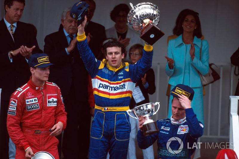 """David Coulthard, Olivier Panis and Johnny Herbert on the 1996 Monaco podium<span class=""""copyright"""">Sutton Images</span>"""