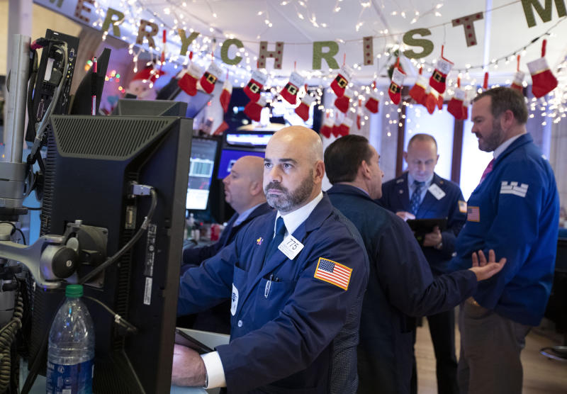 NEW YORK, Dec. 13, 2019 -- Traders work at the New York Stock Exchange in New York, the United States, on Dec. 13, 2019. U.S. stocks ended higher on Friday as investors digested updates about U.S.-China trade and a slew of economic data. The Dow Jones Industrial Average rose 3.33 points, or 0.01 percent, to 28,135.38. The S&P 500 rose 0.23 points, or 0.01 percent, to 3,168.80. The Nasdaq Composite Index was up 17.56 points, or 0.20 percent, to 8,734.88. (Photo by Wang Ying/Xinhua via Getty) (Xinhua/Wang Ying via Getty Images)
