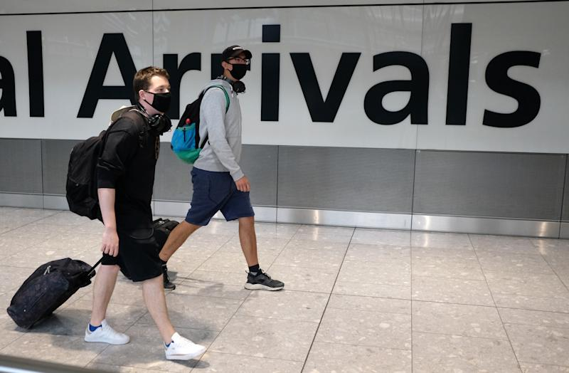 Passengers arrive at Heathrow Airport, following an announcement on Saturday that holidaymakers who had not returned from Spain and its islands by midnight would be forced to quarantine for 14 days after Covid-19 second wave fears saw the European country struck off the UK's safe list. The decision was made after Spain recorded more than 900 fresh daily Covid-19 cases for two days running. (Photo by Andrew Matthews/PA Images via Getty Images)