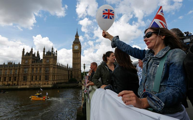 A campaigner on the flotilla protesting against the EU on the Thames before the referendum - Credit: Luke MacGregor/Bloomberg