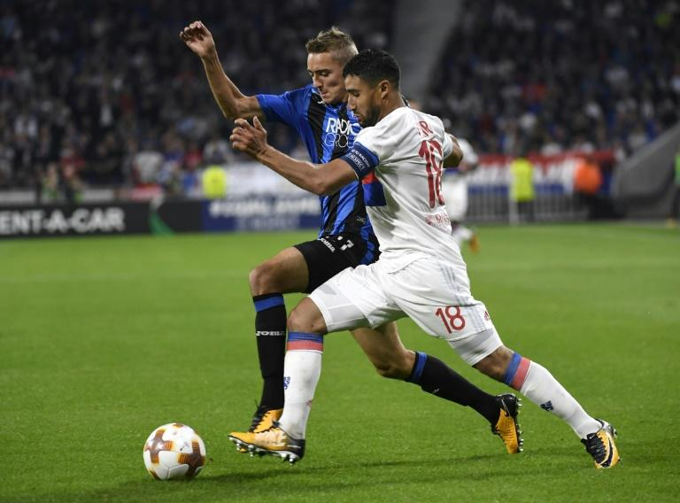 Lyon's Nabil Fekir (R) fights for the ball with Atalanta's Timothy Castagne during their UEFA Europa Cup group stage match, at The Groupama Stadium in Lyon, south-eastern France, on September 28, 2017