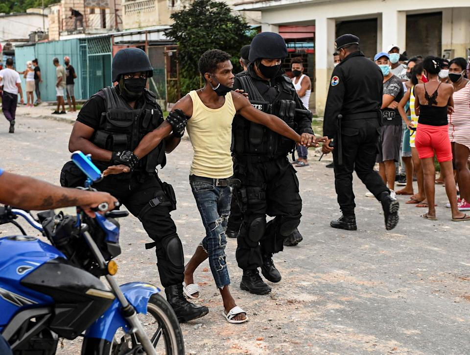 A man is arrested during a demonstration against the government of President Miguel Diaz-Canel in Arroyo Naranjo Municipality, Havana on July 12, 2021. - Cuba on Monday blamed a