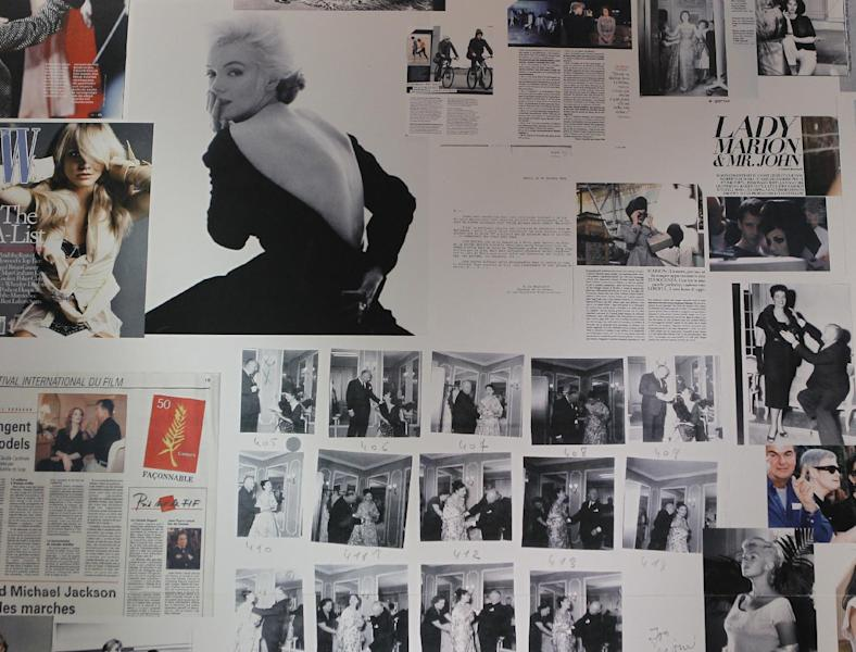 Newspapers and photographs forming part of an exhibition on Christian Dior are seen on the wall of Christian Dior Museum in Granville, Normandy, France, Thursday, May 10, 2012. Going back to where it all began, a new exhibit in the childhood home of legendary designer Christian Dior in Normandy sheds new light on the house's huge contribution to the silver screen.The setting also provides rare insight into how a young Dior - a mama's boy who liked to spend time in the garden - became inspired by the Granville landscape and decided to dedicate his life to fashion. (AP Photo/Jacques Brinon)