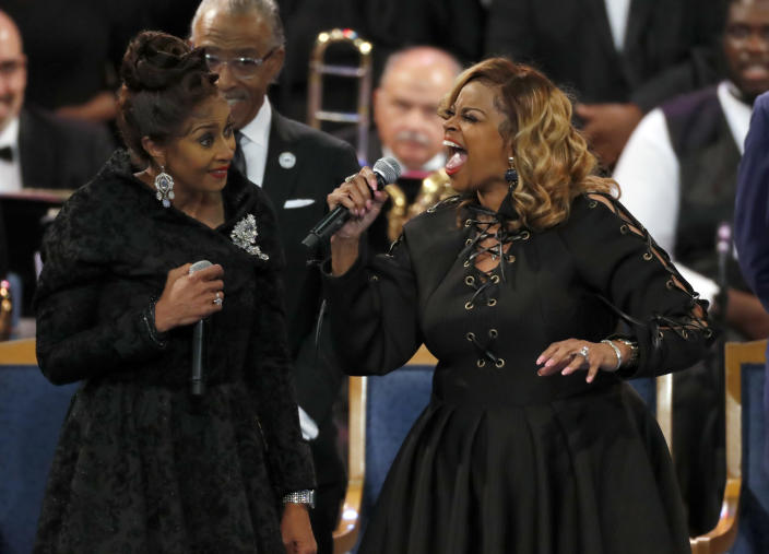 The Clark sisters, Dorinda Clark Cole, left, and Karen Clark Sheard perform during the funeral service for Aretha Franklin at Greater Grace Temple, Friday, Aug. 31, 2018, in Detroit. Franklin died Aug. 16, 2018 of pancreatic cancer at the age of 76. (AP Photo/Paul Sancya)