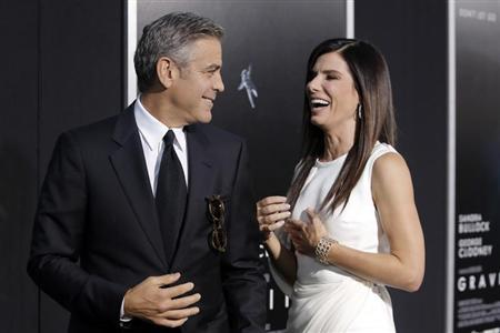 """Actors George Clooney and Sandra Bullock arrive for the film premiere of """"Gravity"""" in New York"""