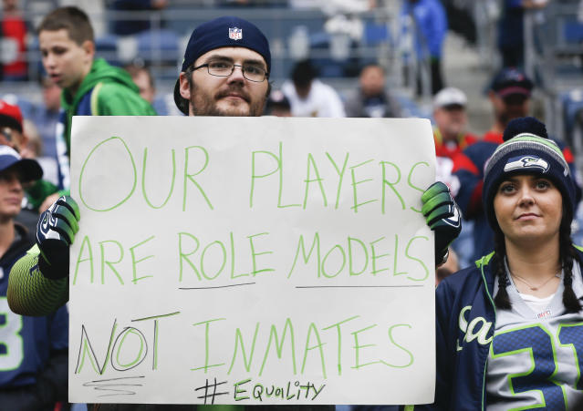 "A Seahawks fan holds a sign referencing a comment made by <a class=""link rapid-noclick-resp"" href=""/nfl/teams/hou/"" data-ylk=""slk:Houston Texans"">Houston Texans</a> owner Bob McNair before the game between the Houston Texans and <a class=""link rapid-noclick-resp"" href=""/nfl/teams/sea/"" data-ylk=""slk:Seattle Seahawks"">Seattle Seahawks</a> at CenturyLink Field on October 29, 2017. (Getty)"