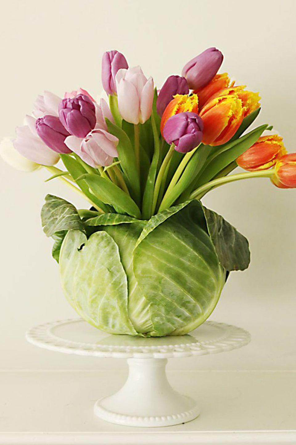 """<p>To pull off this genius vase, cut a hole in the top of a head of cabbage and put a wet foam block inside to stick stems into.</p><p><em><a href=""""http://darlingdarleen.com/2016/03/cabbage-flower-arrangement/"""" rel=""""nofollow noopener"""" target=""""_blank"""" data-ylk=""""slk:Get the tutorial at Darling Darleen »"""" class=""""link rapid-noclick-resp"""">Get the tutorial at Darling Darleen »</a></em></p><p><strong><em>Ceramic Cabbage Vase, $65</em></strong> <a class=""""link rapid-noclick-resp"""" href=""""https://go.redirectingat.com?id=74968X1596630&url=https%3A%2F%2Fwww.etsy.com%2Flisting%2F906807917%2Fvintage-h-hd-cabbage-canister-with%3Fref%3Dlandingpage_similar_listing_top-5%26pro%3D1%26frs%3D1&sref=https%3A%2F%2Fwww.housebeautiful.com%2Fentertaining%2Fflower-arrangements%2Fg19409803%2Feaster-flower-arrangements%2F"""" rel=""""nofollow noopener"""" target=""""_blank"""" data-ylk=""""slk:BUY NOW"""">BUY NOW</a></p>"""