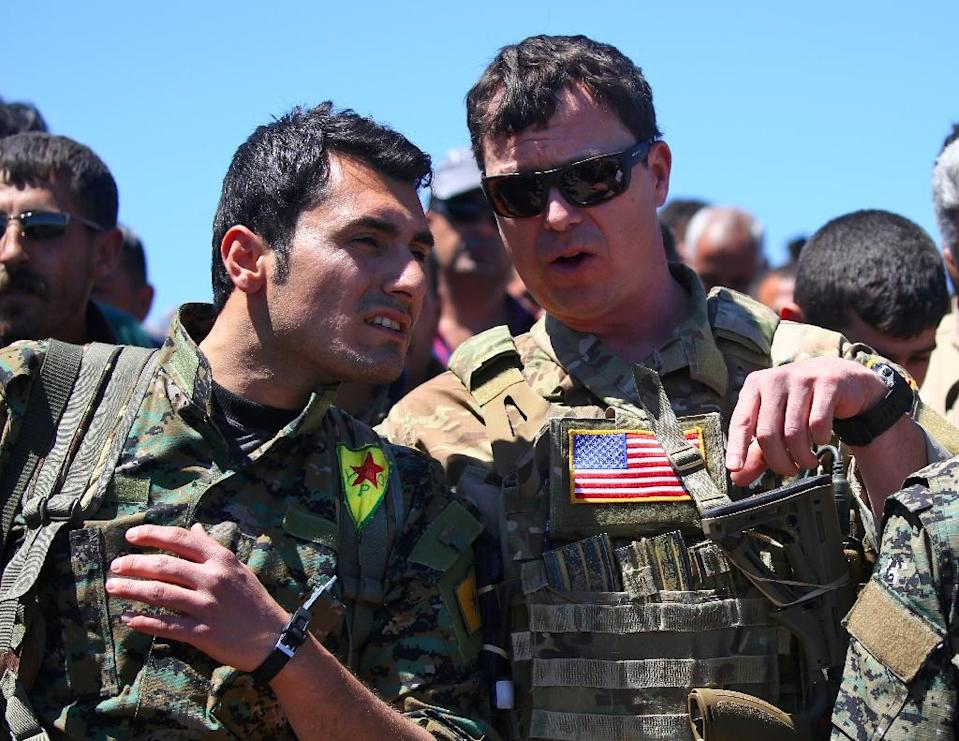 """The YPG militia is a valued ally of the US, but branded a 'terrorist organisation"""" by Ankara (AFP Photo/DELIL SOULEIMAN)"""