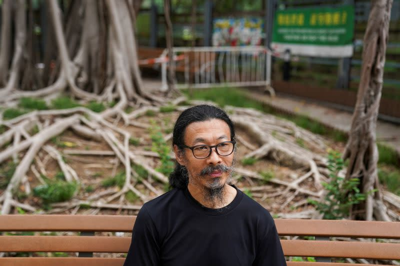 Labour rights activist Han Dongfang poses for a picture outside Victoria Park in Hong Kong