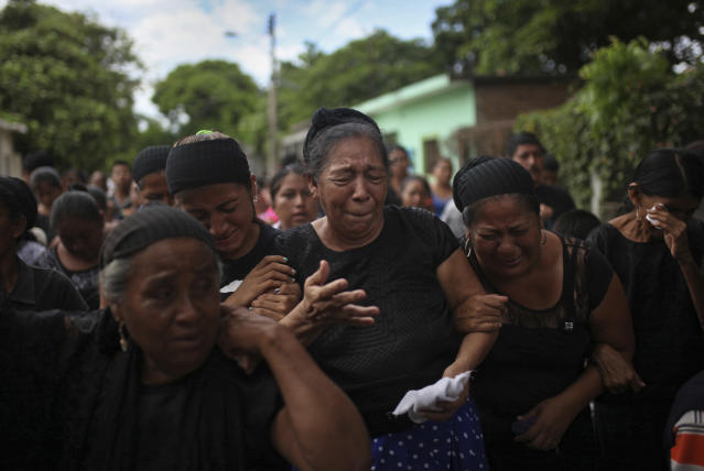<p>Relatives of 38-year-old earthquake victim policeman Juan Jimenez Regalado weep during his funeral in Juchitan, Oaxaca state, Mexico, Sunday Sept. 10, 2017. Thursday's 8.1 magnitude earthquake destroyed a large part of Juchitan and killed at least 37 people, even as officials on Sunday raised the nationwide death toll to 90.(AP Photo/Felix Marquez) </p>