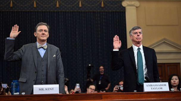 PHOTO: George Kent and Bill Taylor take the oath during the impeachment inquiry into President Donald Trump in Washington, Nov. 13, 2019. (Andrew Caballero-reynolds/AFP via Getty Images)