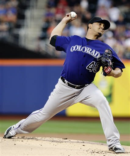 Colorado Rockies' Jhoulys Chacin delivers a pitch during the first inning of a baseball game against the New York Mets, Tuesday, Aug. 21, 2012, in New York. (AP Photo/Frank Franklin II)