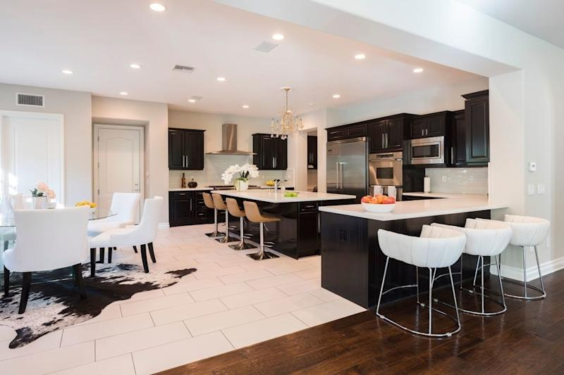 The black-and-white kitchen features multiple dining areas.