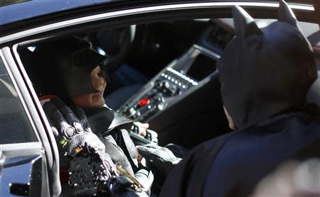"""Five-year-old leukemia survivor Miles Scott, dressed as """"Batkid"""" speaks to Batman as he sits in the Batmobile as part of a day arranged by the Make- A - Wish Foundation in San Francisco, California November 15, 2013. REUTERS/Stephen Lam"""