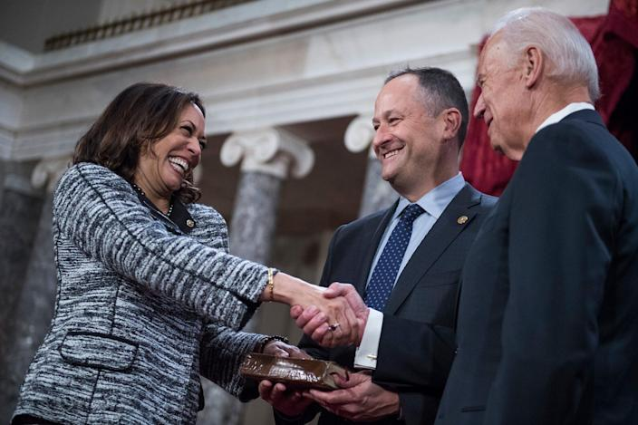 <p>In 2017, she was sworn in by her future running mate, Joe Biden, as her husband, Doug Emhoff, held the Bible on which she swore. </p>