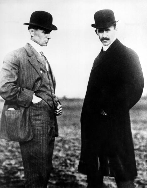 FILE - Wilbur Wright, left, and Orville Wright are shown in this undated file photo.The Wright brothers worked together to build and fly the first Wright Biplane, which made a successful flight on December 17, 1903 at Kill Devil Hills near Kitty Hawk, North Carolina. The Wright brothers have long been credited as the first to achieve powered flight. But in June, 2013, Connecticut Gov. Dannel P. Malloy signed a law giving credit to German-born aviator and Connecticut resident Gustave Whitehead. On Thursday, Oct. 24, 1013,Ohio state Rep. Rick Perales and North Carolina state Sen. Bill Cook held news conferences to dispute Connecticut's action and reassert the Wright Brothers were first in flight. (AP Photo/File)
